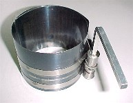 wind up band type piston ring compressor